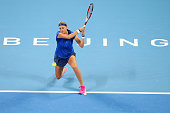 Petra Kvitova of the Czech Republic plays a backhand in her match against Shuai Peng of China during day five of of the China Open at the National...