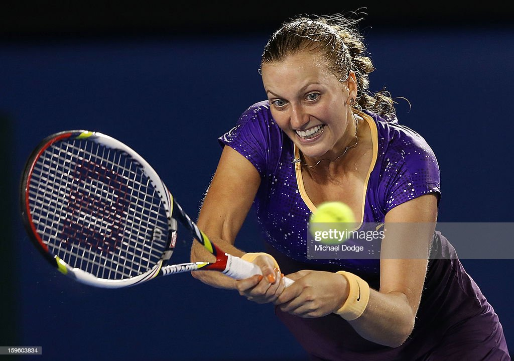 Petra Kvitova of the Czech Republic plays a backhand in her second round match against Laura Robson of Great Britain during day four of the 2013 Australian Open at Melbourne Park on January 17, 2013 in Melbourne, Australia.