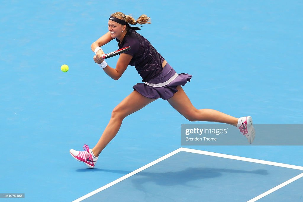 Petra Kvitova of the Czech Republic plays a backhand in her second round match against Christina McHale of the USA during day three of the 2014...