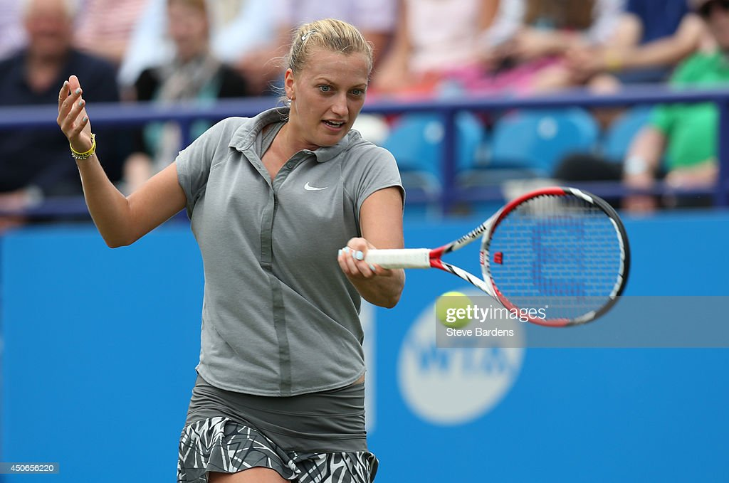 Petra Kvitova of the Czech Republic plays a forehand during the Rally for Bally mixed doubles charity match on day two of the Aegon International at Devonshire Park on June 15, 2014 in Eastbourne, England.