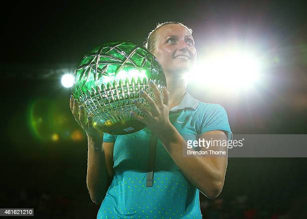 Petra Kvitova of the Czech Republic poses with the trophy after winning the Womens Singles Final match against Karolina Pliskova of the Czech...