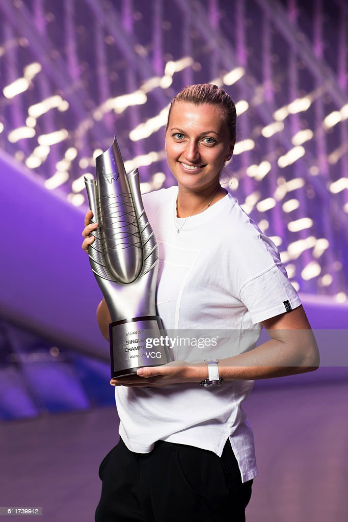 Petra Kvitova of the Czech Republic poses with the trophy for the champion portrait after winning the women's single final match against Dominika Cibulkova of Slovak on day seven of the 2016 WTA Dongfeng Motor Wuhan Open on October 1, 2016 in Wuhan, Hubei Province of China.