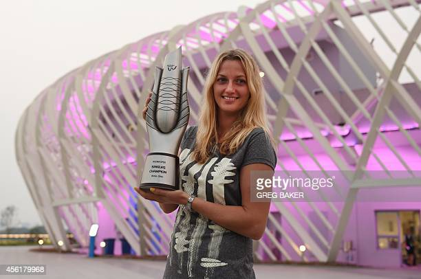 Petra Kvitova of the Czech Republic poses with the trophy outside the center court stadium after her win over Eugenie Bouchard of Canada in the final...