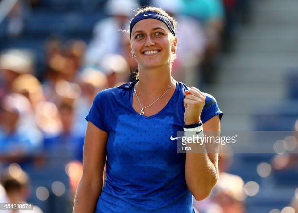 Petra Kvitova of the Czech Republic reacts after defeating Kristina Mladenovic of France to win their women's singles first round match on Day Two of...