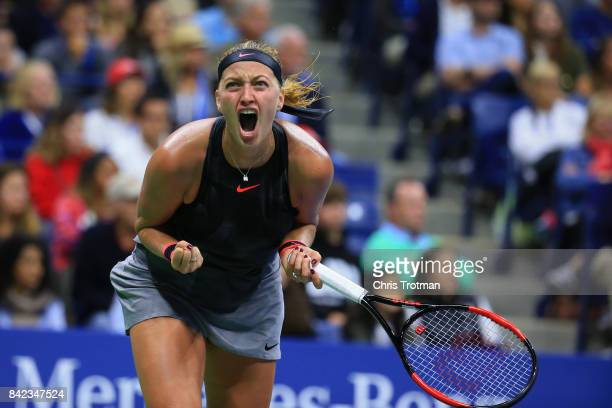 Petra Kvitova of the Czech Republic reacts against Garbine Muguruza of Spain during their fourth round Women's Singles match on Day Seven during the...