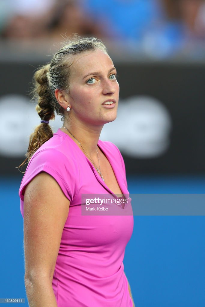 Petra Kvitova of the Czech Republic reacts in her first round match against Luksika Kumkhum of Thailand during day one of the 2014 Australian Open at Melbourne Park on January 13, 2014 in Melbourne, Australia.