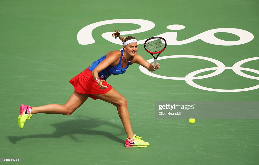 Petra Kvitova of the Czech Republic returns a shot against Monica Puig of Puerto Rico during the Women's Singles Semifinal on Day 7 of the Rio 2016...