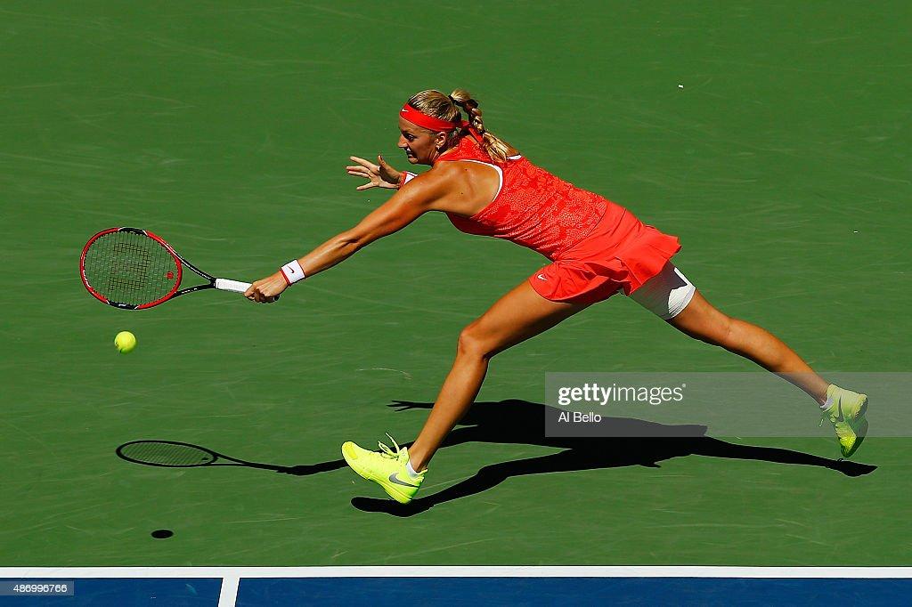 Petra Kvitova of the Czech Republic returns a shot to Anna Karolina Schmiedlova of Slovakia during their Women's Singles Third Round match on Day Six...