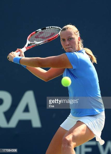Petra Kvitova of the Czech Republic returns a shot to Annika Beck of Germany during Day Three of the New Have Open at Connecticut Tennis Center at...