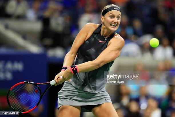Petra Kvitova of the Czech Republic returns a shot to Garbine Muguruza of Spain during their fourth round Women's Singles match between on Day Seven...