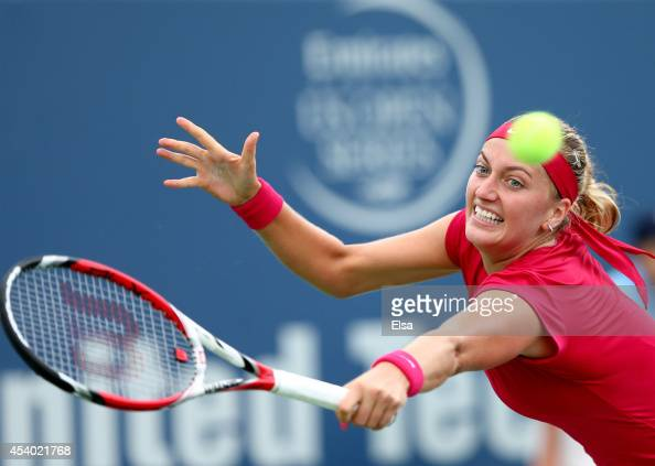 Petra Kvitova of the Czech Republic returns a shot to Magdalena Rybarikova of Slovakia during the women's final of the Connecticut Open at the...