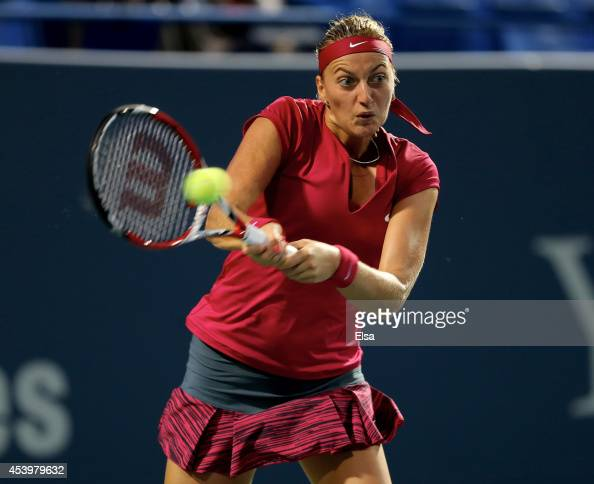 Petra Kvitova of the Czech Republic returns a shot to Samantha Stosur of Australia during the Connecticut Open at the Connecticut Tennis Center at...