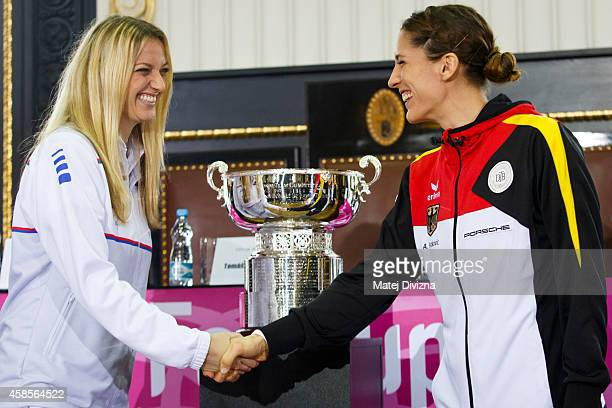 Petra Kvitova of the Czech Republic shakes hands with first day opponent Andrea Petkovic of Germany after a draw ceremony prior to the Fed Cup final...