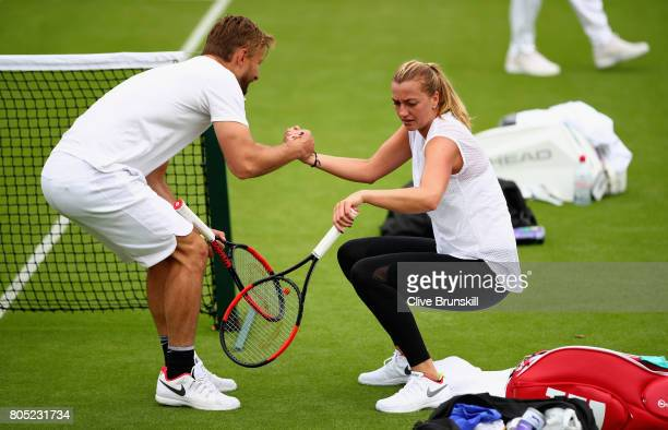 Petra Kvitova of the Czech Republic with her coach during a practice session ahead of the Wimbledon Lawn Tennis Championships at the All England Lawn...