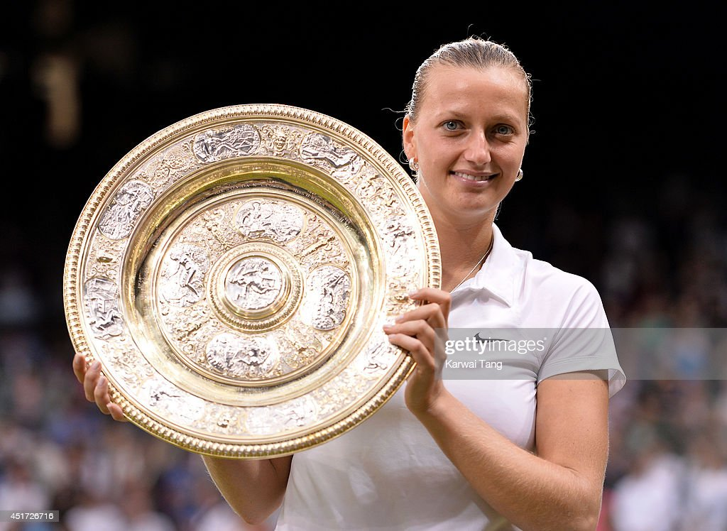 Petra Kvitova poses with the Venus Rosewater Dish after beating Eugenie Bouchard in the ladies singles final on centre court during day twelve of the Wimbledon Championships at Wimbledon on July 5, 2014 in London, England.