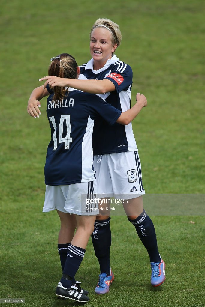 Petra Larsson (R) of Melbourne congratulates her teammate Enza Barilla (L) after Barilla scored a goal during the round seven W-League match between Adelaide United and the Melbourne Victory at Burton Park on December 1, 2012 in Adelaide, Australia.