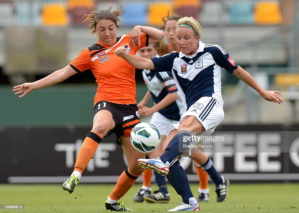 Petra Larsson of the Victory takes a shot at goal as she is pressured by the defence of Vedrana Popovic of the Roar during the round six W-League match between the Brisbane Roar and the Melbourne Victory at the Queensland Sport and Athletics Centre on November 24, 2012 in Brisbane, Australia.