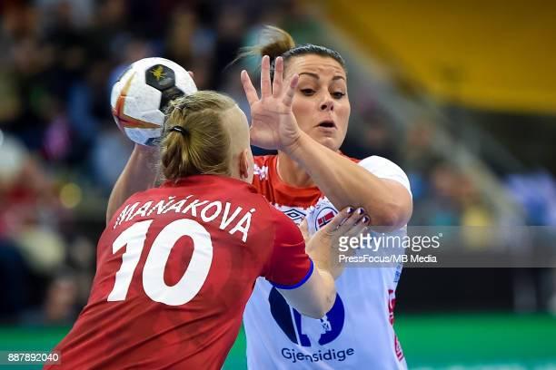 Petra Manakova of Czech Republic and Nora Mork of Norway vie for the ball during IHF Women's Handball World Championship group B match between Czech...