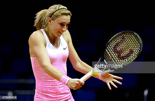 Petra Martic of Croatia hits a backhand during her first round match against Marina Melnikova of Russia on day two of the Porsche Tennis Grand Prix...