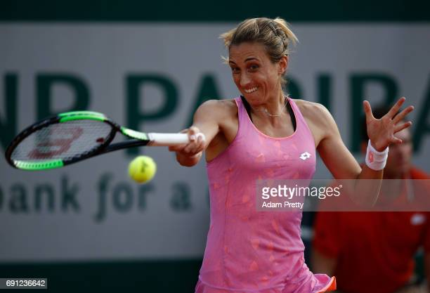Petra Martic of Croatia hits a forehand during the ladies singles second round match against Madison Keys of the United States on day five of the...