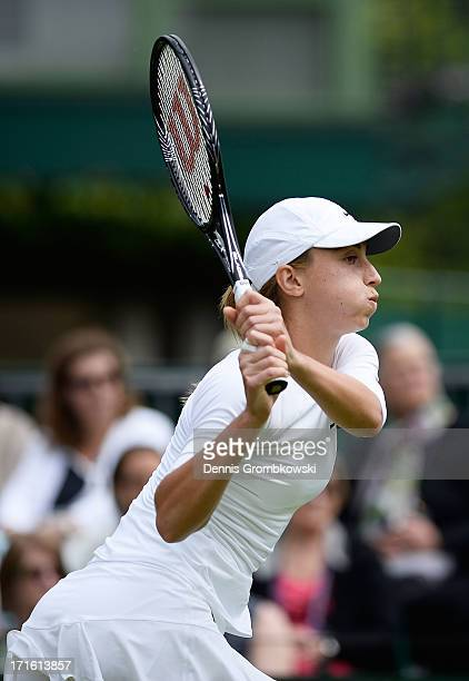 Petra Martic of Croatia plays a backhand during the Ladies' Singles second round match against Karolina Pliskova of Czech Republic on day four of the...
