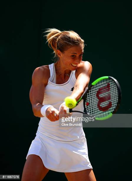 Petra Martic of Croatia plays a backhand during the Ladies Singles fourth round match against Magdalena Rybarikova of Slovakia on day seven of the...