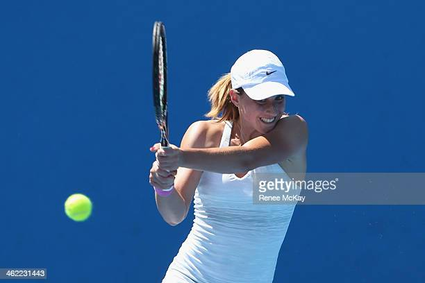 Petra Martic of Croatia plays a backhand in her first round match against Annika Beck of Germany during day one of the 2014 Australian Open at...