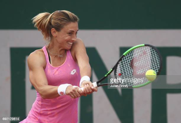 Petra Martic of Croatia plays a backhand in her women's singles third round match against Anastasija Sevastova of Latvia during day eight of the...