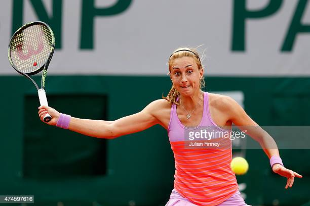 Petra Martic of Croatia plays a forehand during her Women's Singles match against Garbine Muguruza of Spain on day one of the 2015 French Open at...