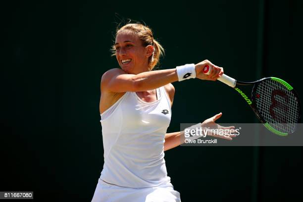 Petra Martic of Croatia plays a forehand during the Ladies Singles fourth round match against Magdalena Rybarikova of Slovakia on day seven of the...