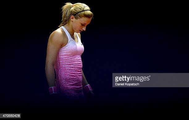Petra Martic of Croatia reacts during her first round match against Marina Melnikova of Russia on day two of the Porsche Tennis Grand Prix at...