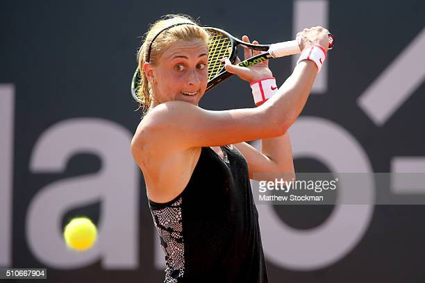 Petra Martic of Croatia returns a shot to Teliana Perreira of Brazil during the Rio Open at Jockey Club Brasileiro on February 16 2016 in Rio de...