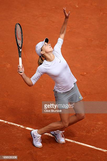 Petra Martic of Croatia serves in her Women's Singles match against Ana Ivanovic of Serbia during day one of the French Open at Roland Garros on May...