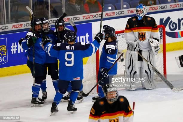 Petra Nieminen of Finland celebrates her second period goal with Jenni Hiirikoski Venla Hovi Anna Kilponen and Linda Valimaki next to Ivonne Schroder...