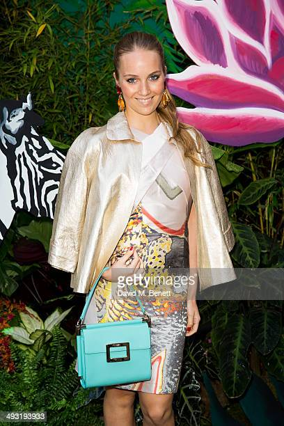 Petra Palombo arrives at Roger Vivier Summer Party at Loulou's on May 22 2014 in London England