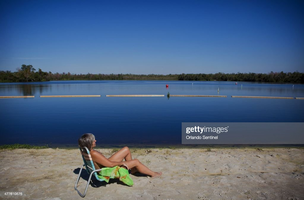 Petra Scheller a snowbird from Canada relaxes near the lake at Cypress Cove Nudist Resort Spa Feb 19 2014 The nudist resort in Kissimmee celebrates...