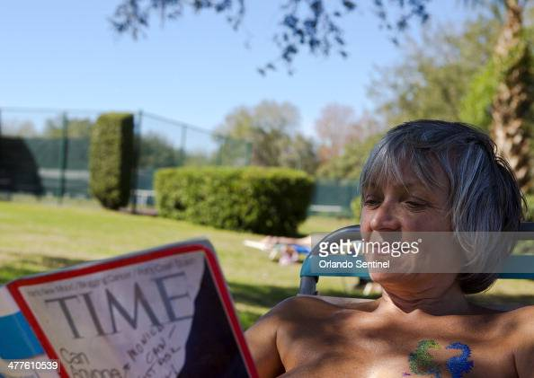 Petra Scheller a snowbird from Canada relaxes while reading near the lake at Cypress Cove Nudist Resort Spa Feb 19 2014 The nudist resort in...