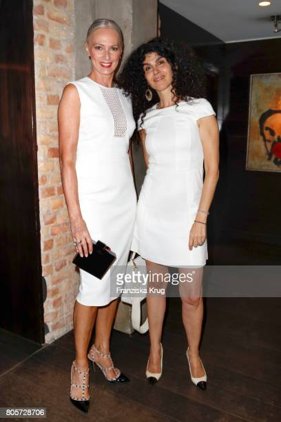 Petra van Bremen and Janine White attend the Annabelle Mandeng Hosts Ladies Dinner In Berlin on July 2 2017 in Berlin Germany