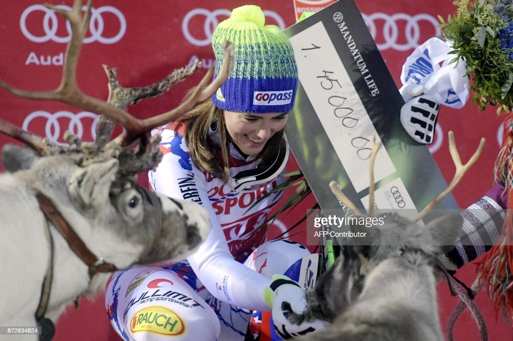 Petra Vlhova of Slovakia celebrates her victory on the podium with reindeer after the Ladies' FIS Alpine Ski World Cup slalom race in Levi, Kittilae, Finland, on November 11, 2017. / AFP PHOTO / Lehtikuva / Vesa Moilanen / Finland OUT