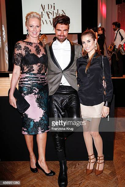 Petra von Bremen Andre Borchers and Cathy Fischer attend the Audi Fashion Award 2014 on October 09 2014 in Hamburg Germany