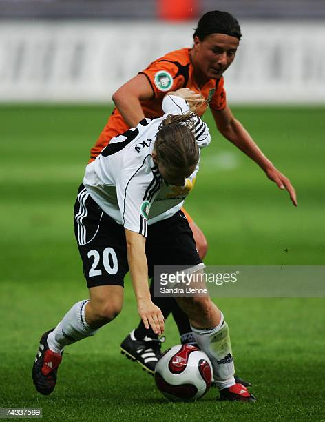 Petra Wimbersky of Frankfurt and Verena Hagedorn of Duisburg battle for the ball during the Women's German Cup Final match between FFC Frankfurt and...