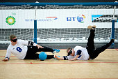 Petri Posio of Finland and teammate Erkki Miinala block the ball during their Men's Team Goalball Bronze Medal match between against Brazil on day 9...