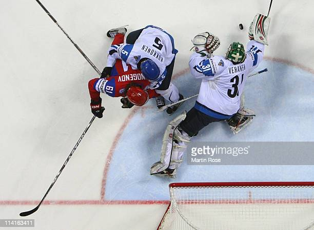 Petri Vehanen goaltender of Finland and makes a save against Maxim Afinogenov during the IIHF World Championship semi final match between Finland and...