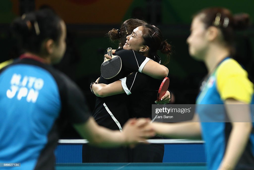 Petrissa Solja and Xiaona Shan of Germany celebrate defeating Ai Fukuhara and Mima Ito of Japan in the 3rd match doubles during the Women's Team Semifinal 2 on Day 9 of the Rio 2016 Olympic Games at Riocentro - Pavilion 3 on August 14, 2016 in Rio de Janeiro, Brazil.