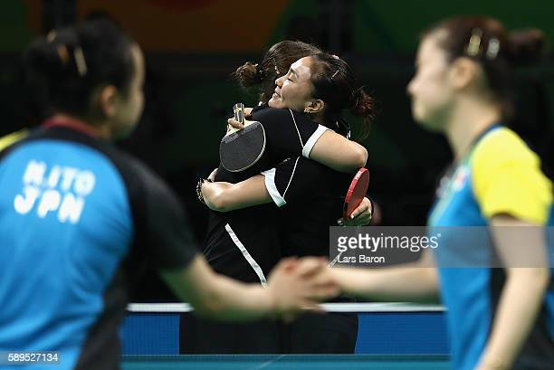 Petrissa Solja and Xiaona Shan of Germany celebrate defeating Ai Fukuhara and Mima Ito of Japan in the 3rd match doubles during the Women's Team...