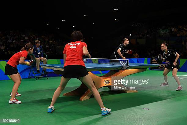 Petrissa Solja and Xiaona Shan of Germany play a doubles match against Shiwen Liu and Ning Ding of China in the Women's Team Gold Medal Team Match...