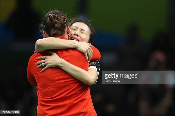 Petrissa Solja and Ying Han of Germany react after defeating Japan 32 in the Women's Team Semifinal 2 on Day 9 of the Rio 2016 Olympic Games at...