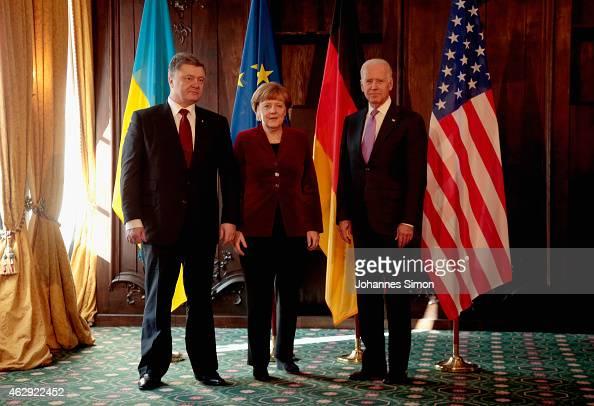Petro Poroshenko president of the Ukraine German Chancellor Angela Merkel and US Vice President Joe Biden pose ahead of a bilateral meeting at the...