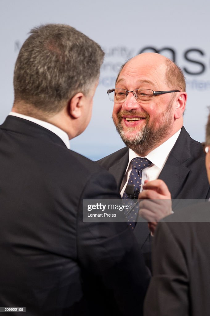 Petro Poroshenko (L), President of Ukraine embraces President of the European Parliament, Martin Schulz at the 2016 Munich Security Conference at the Bayerischer Hof hotel on February 13, 2016 in Munich, Germany. The annual event brings together government representatives and security experts from across the globe and this year the conflict in Syria will be the main issue under discussion.