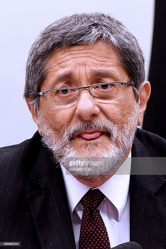 Petrobras former President Jose Sergio Gabrielli gestures during a hearing with the Parliamentary Commission of Inquiry that investigates accusations of corruption in Petrobras, in Brasilia on March 12, 2015. Dozens of politicians from five parties, including from that of Brazilian President Dilma Rousseff, have been implicated in a corrupt network which laundered $4 billion of Brazil's state oil giant money. AFP PHOTO/EVARISTO SA